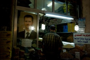 The aroma of coriander and cinnamon thick in the air, the details of Assad's mustached mug lit by a hanging lightbulb outside a spice shop.